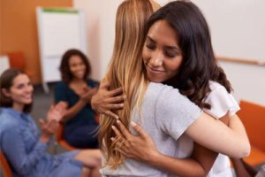 two women hugging during the Women's Rehab Program in ohio